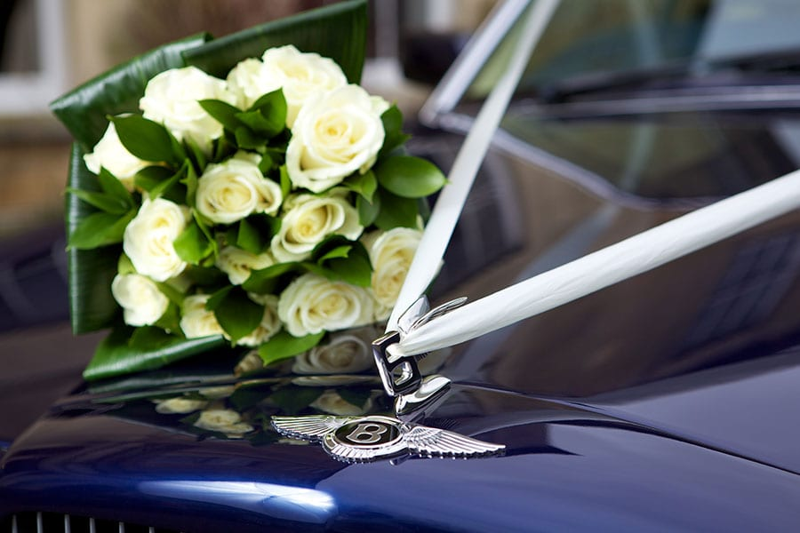 bouquet of flowers on Bentley Brooklands bonnet with ribbon