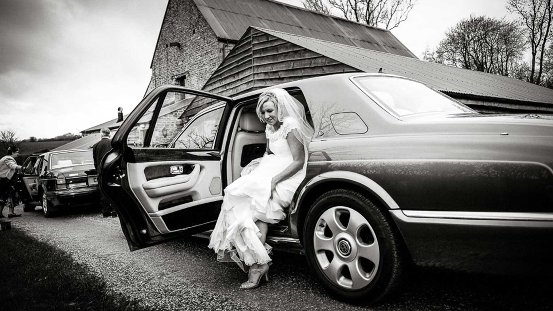 Sophie Stepping out of the Bentley Arnage