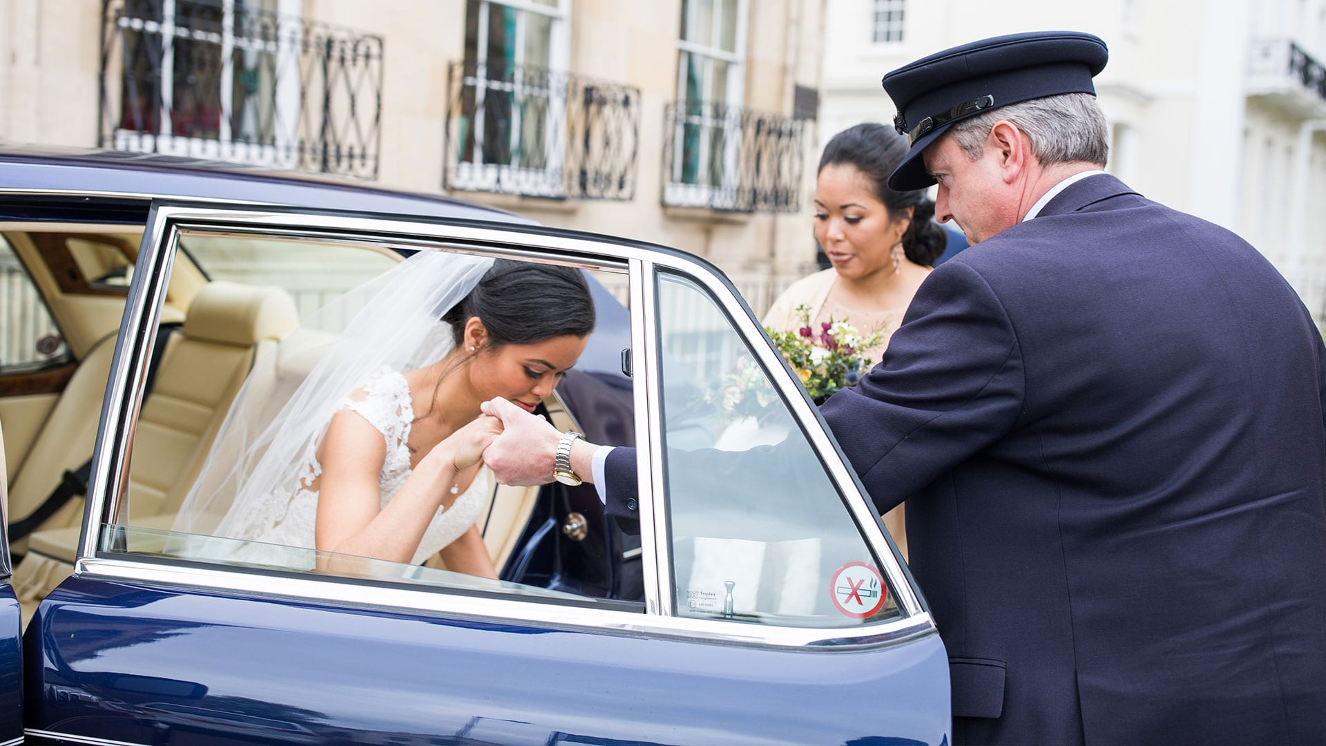 David Keffler assisting bride Elizabeth in stepping out of the Bentley Brooklands