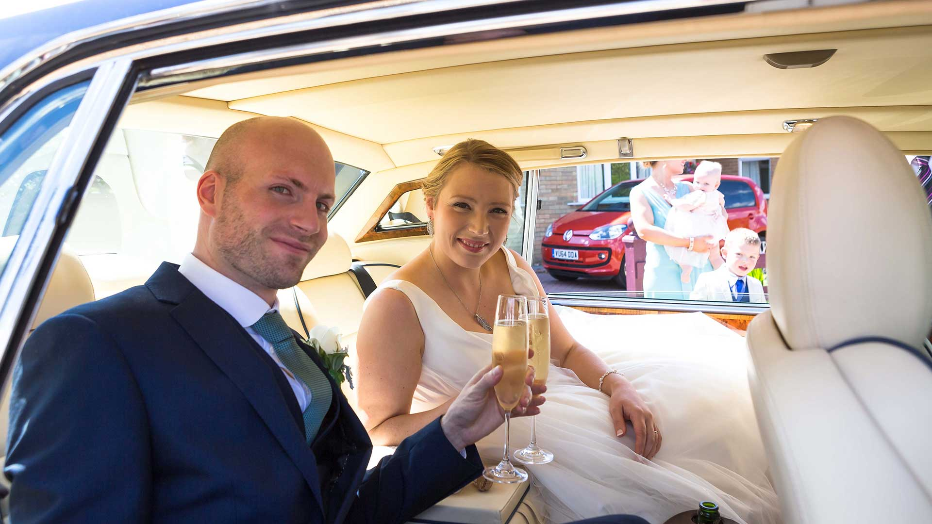James and Jen with their celebratory glass of Champagne in the Bentley Brooklands