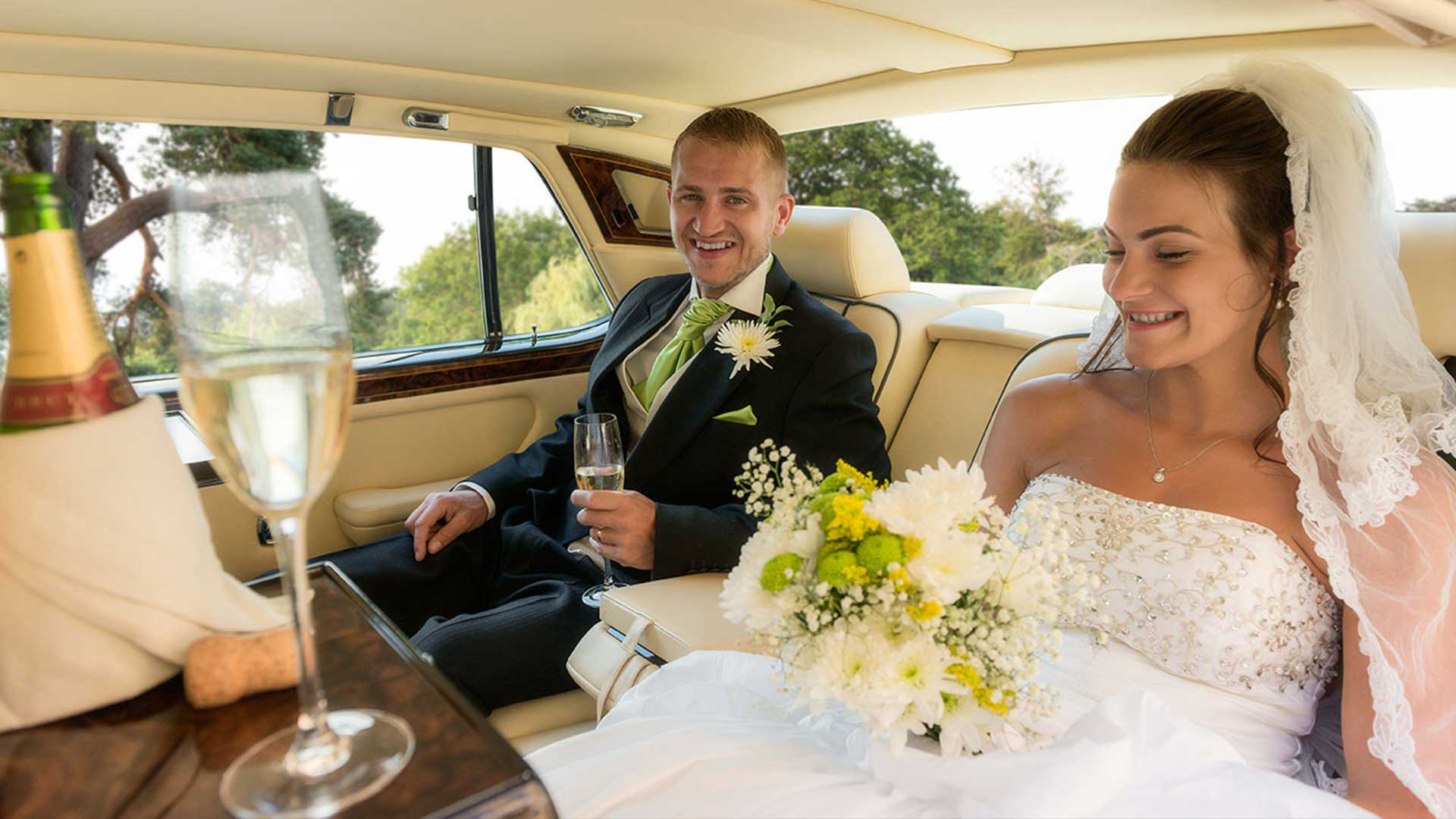 Ben and Kadie in the Rolls-Royce Flying Spur with a celebratory glass of Champagne