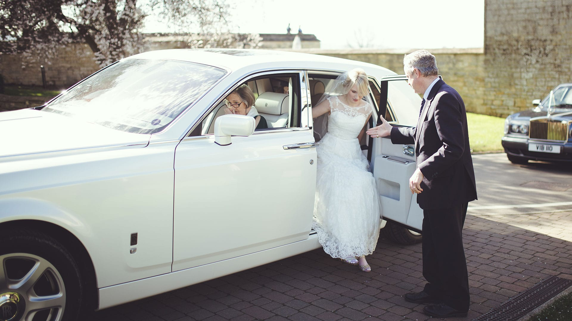 Bride stepping out of the Rolls-Royce Phantom