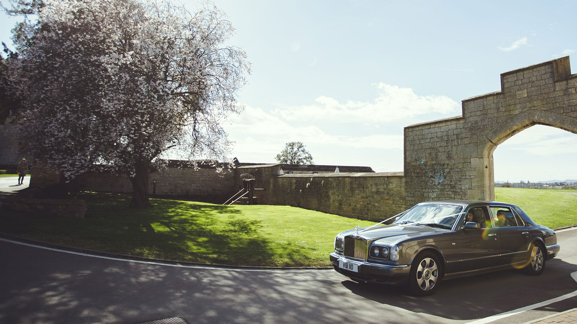 Bentley Bridesmaid's Car in grey arriving at wedding venue