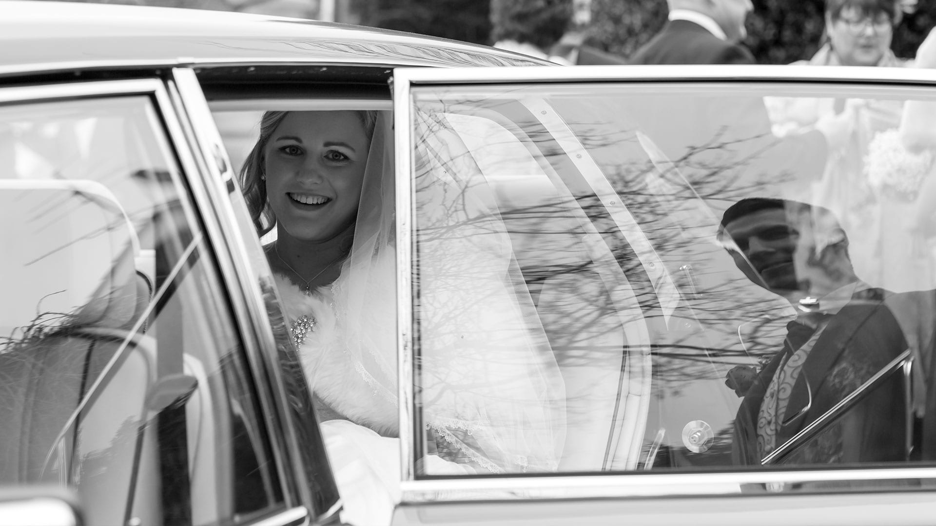 The bride, Danielle, in the Rolls-Royce Flying Spur