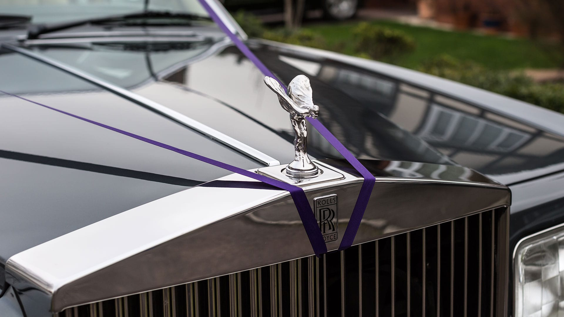 The Rolls-Royce Flying Spur wedding car Spirit of Ecstacy with ribbons