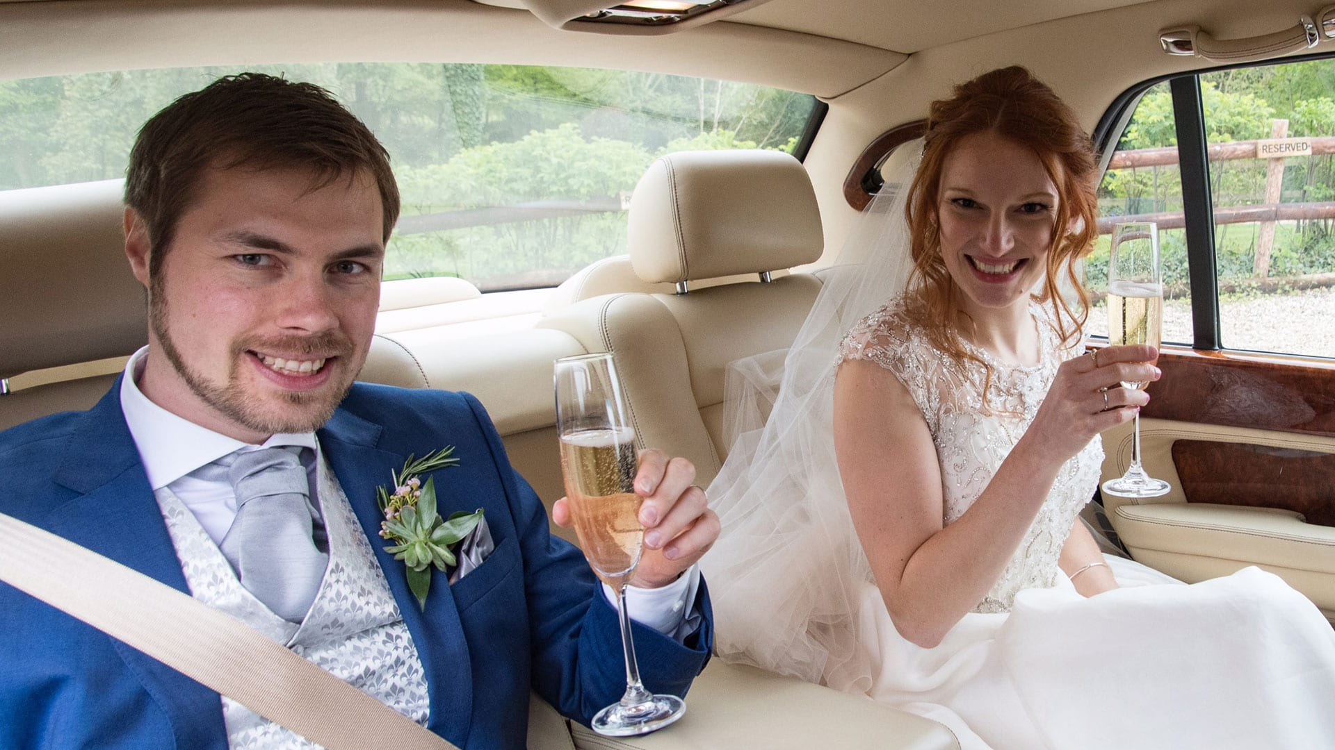 Ben and Beth inside the Bentley Arnage with a glass of celebratory Champagne