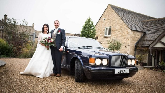 Newly-wed couple Michael and Victoria with the Bentley Brooklands at Hyde Barn