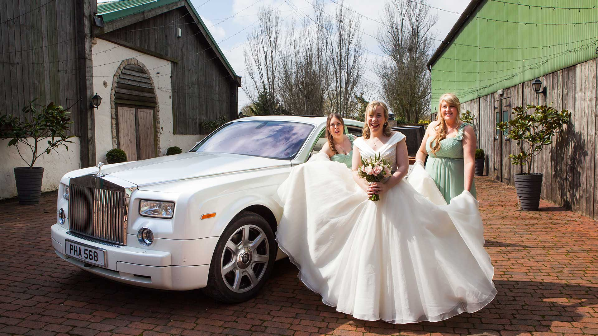 The bride and her bridesmaids with the Rolls-Royce Phantom