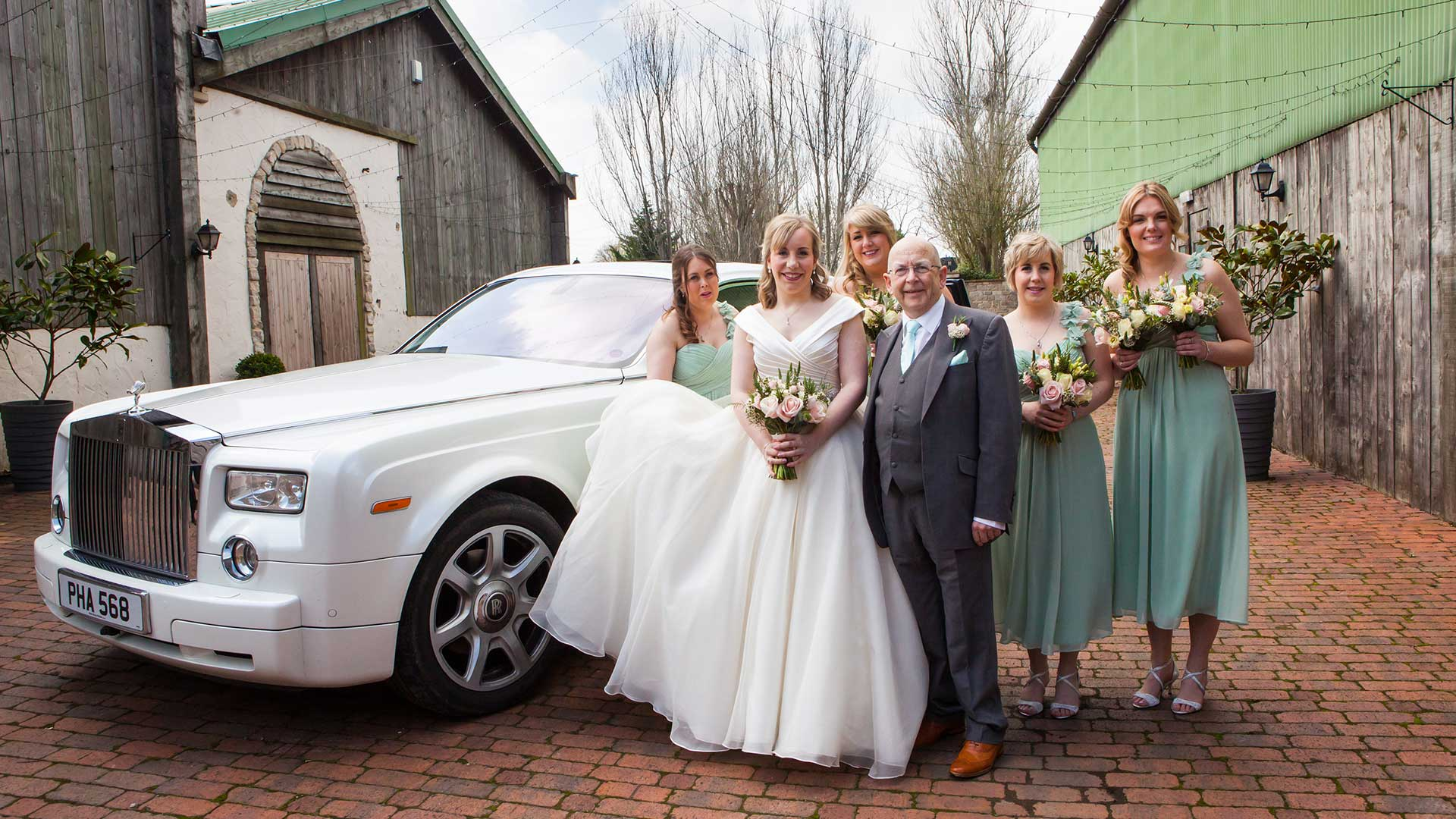The bride, father and her bridesmaids with the Rolls-Royce Phantom