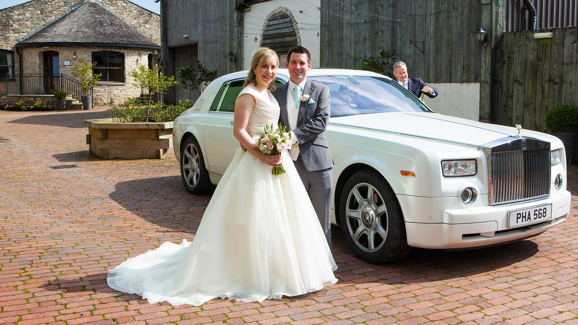 Newly-wed couple Mr and Mrs Bracher with the Rolls-Royce Phantom