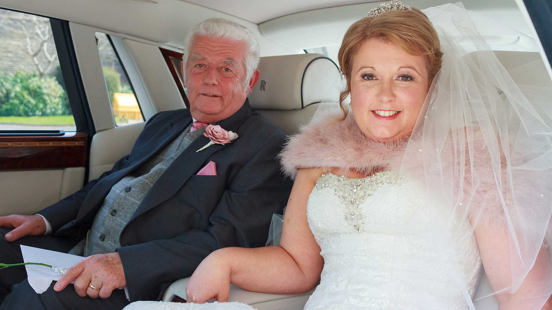 The bride and her Dad in the Rolls-Royce Phantom wedding car