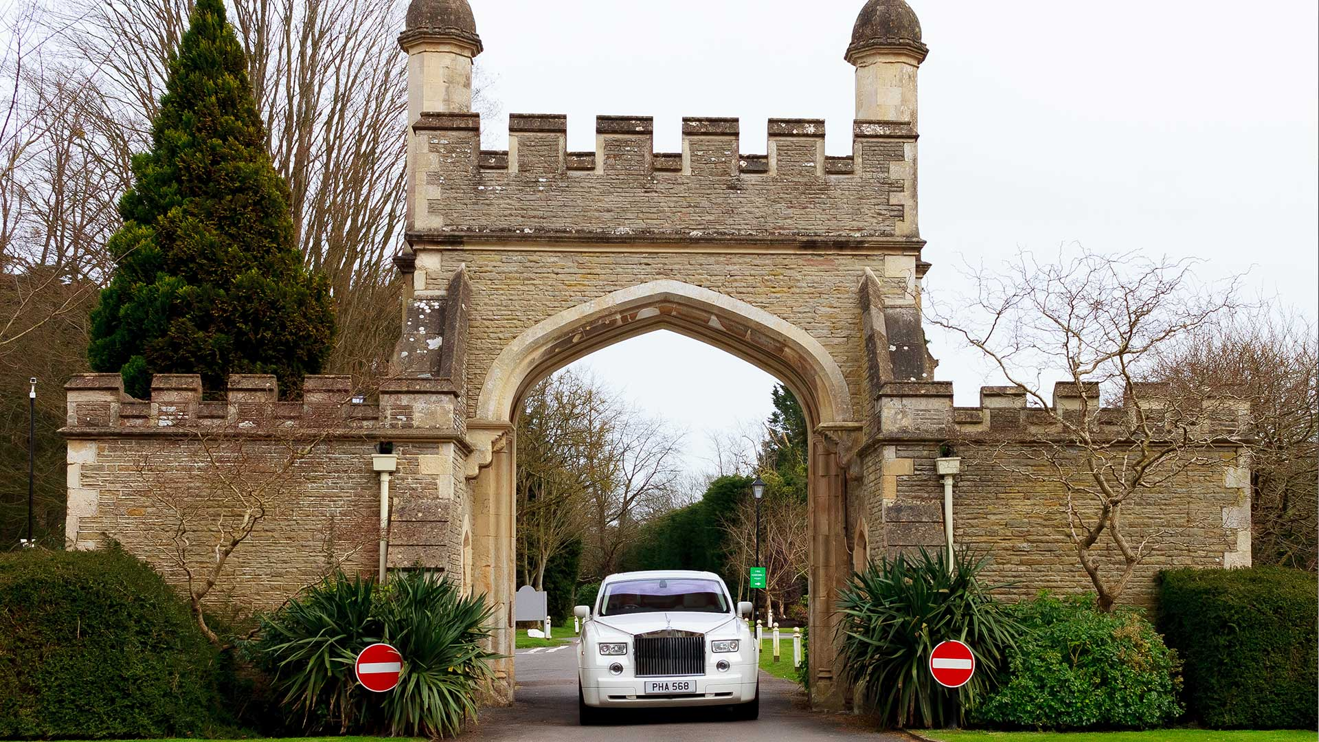 The Rolls-Royce Phantom in white, arriving at Tortworth Court