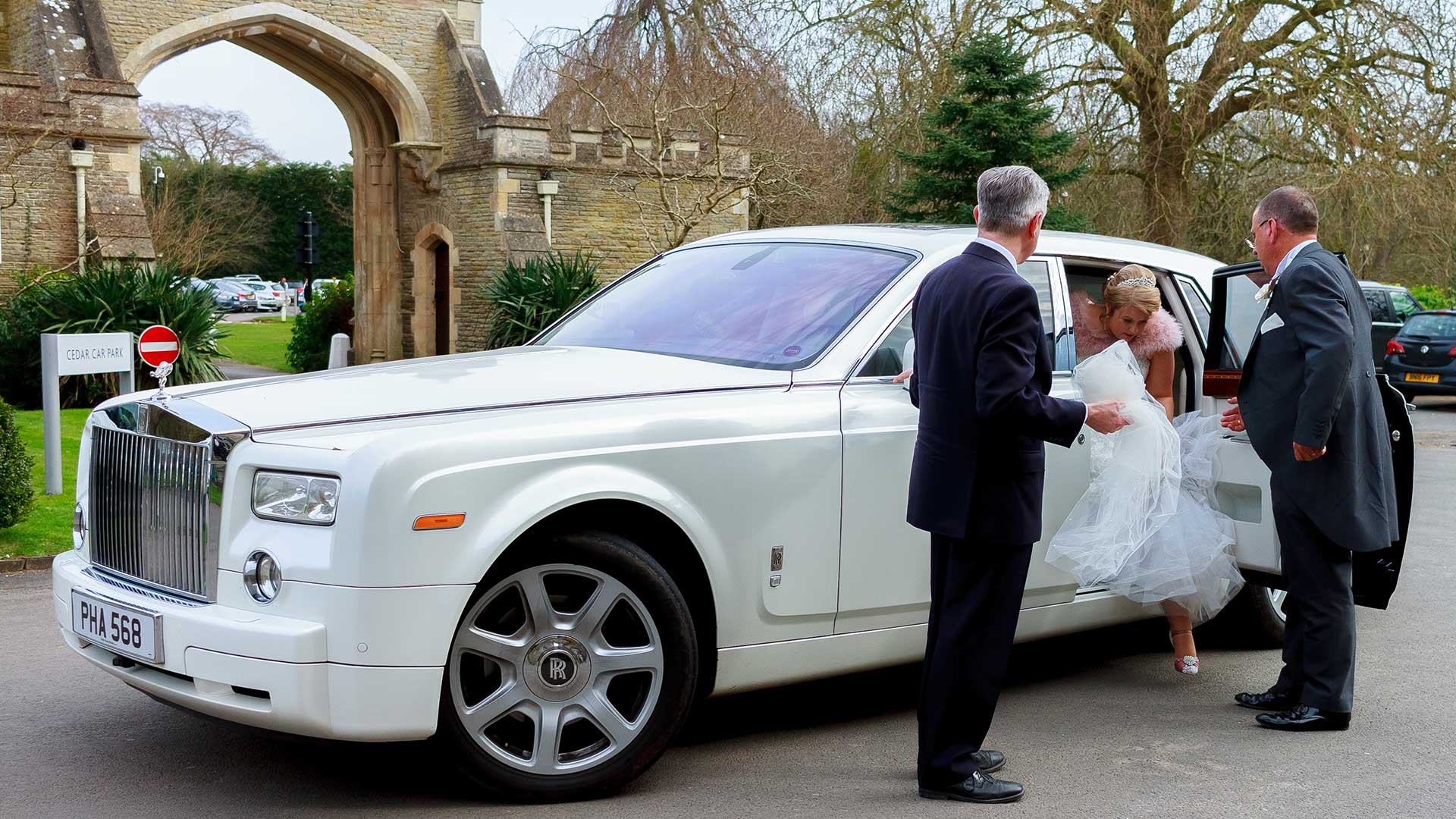 The bride getting out of the Rolls-Royce Phantom