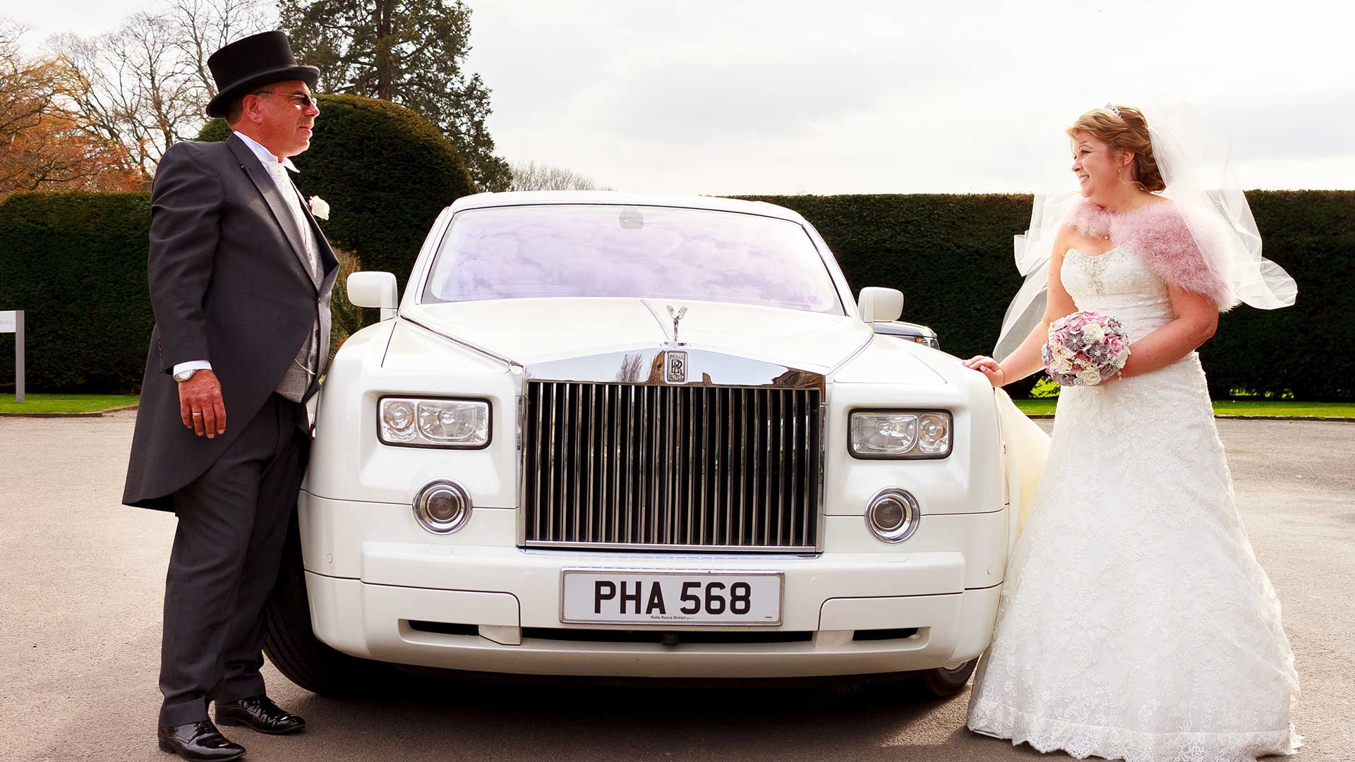 Mr and Mrs Cooney with the Rolls-Royce Phantom