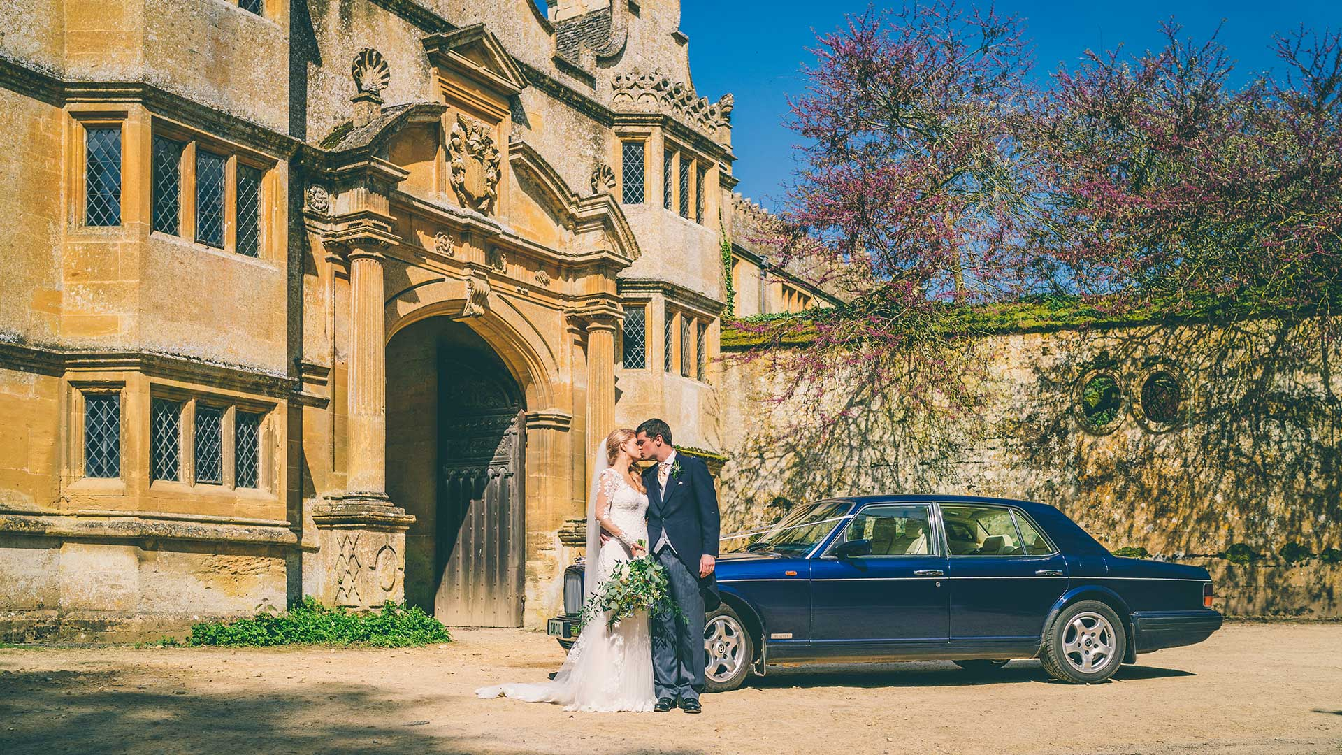 Newly-weds Robyn and Mike at Stanway House with the Bentley Brooklands