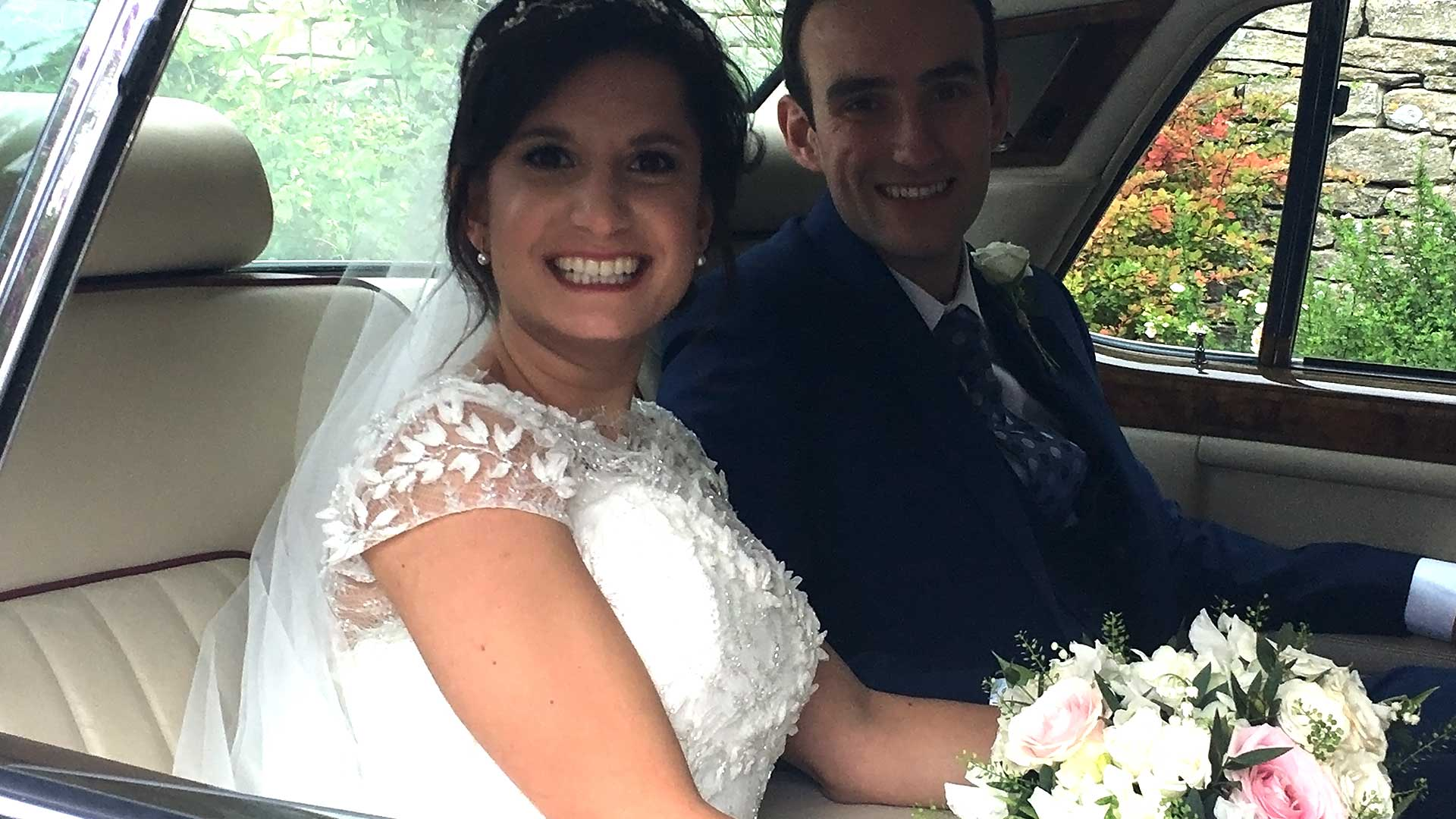 Newly-wed couple Duncan and Katerina in the Rolls-Royce Silver Spur wedding car