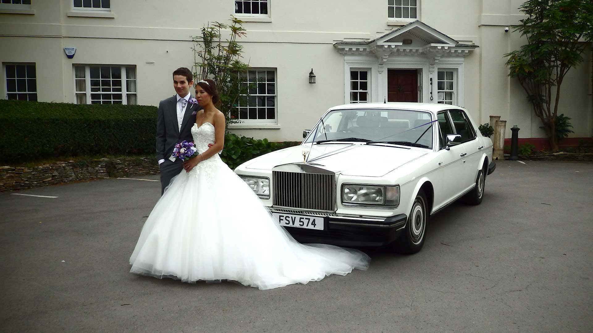 Niall and Elle in front of the Rolls-Royce Silver Spur