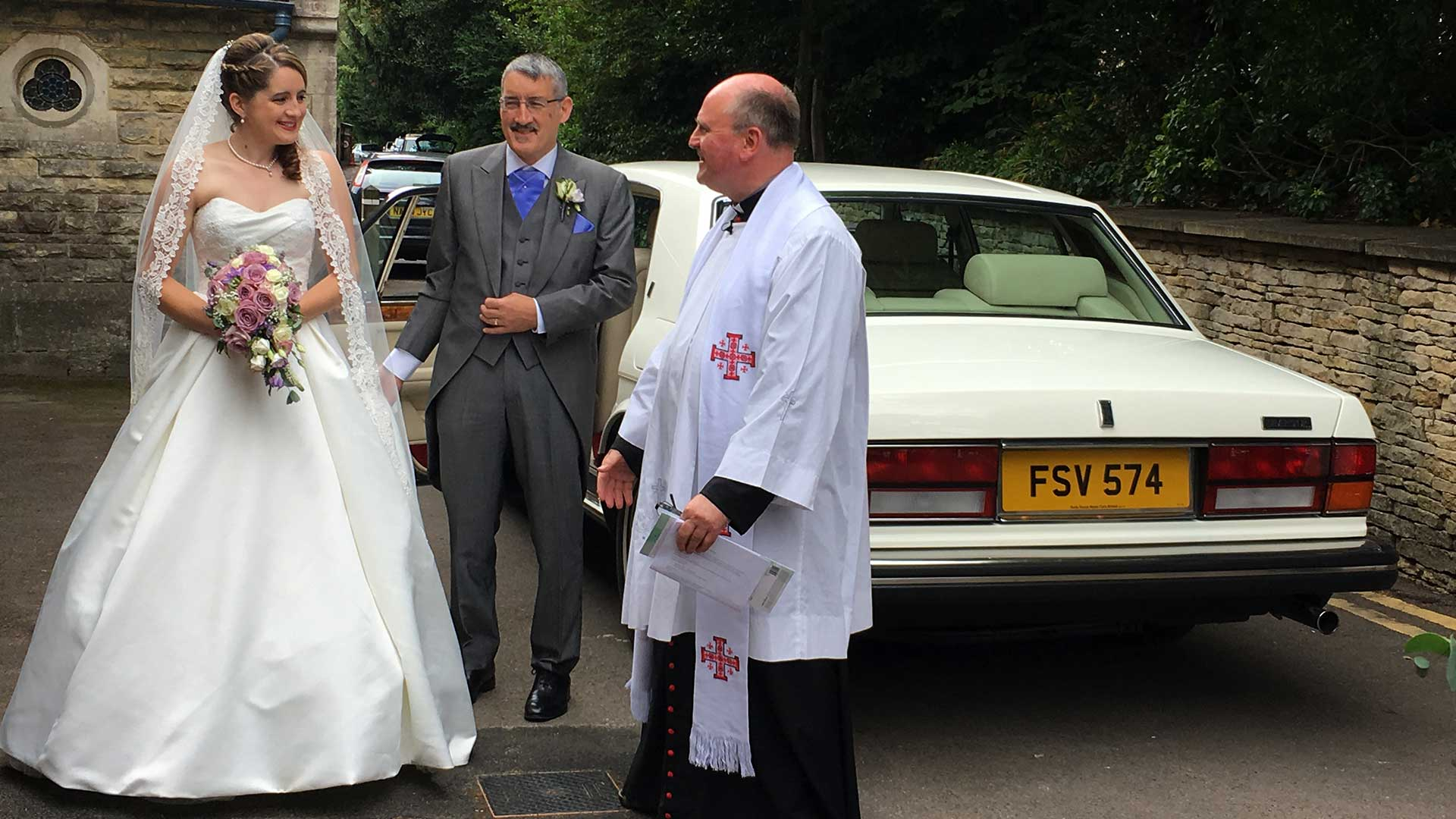 Nadia at the Church with the vicar and her father