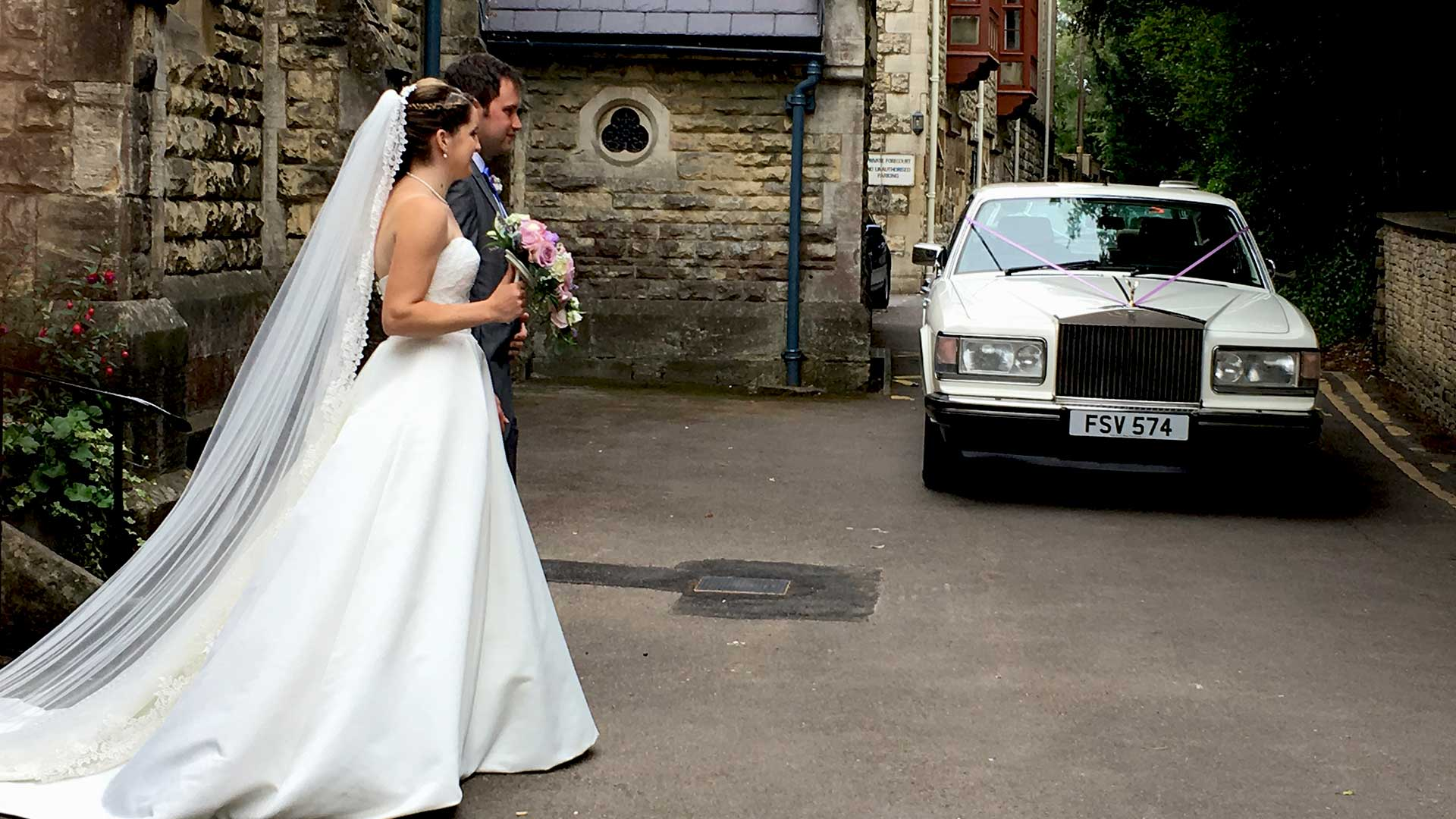 Newly-wed couple Oliver and Nadia walking to the Rolls-Royce Silver Spur