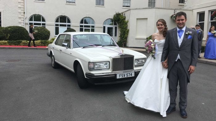 Oliver and Nadia with the Rolls-Royce Silver Spur wedding car in white