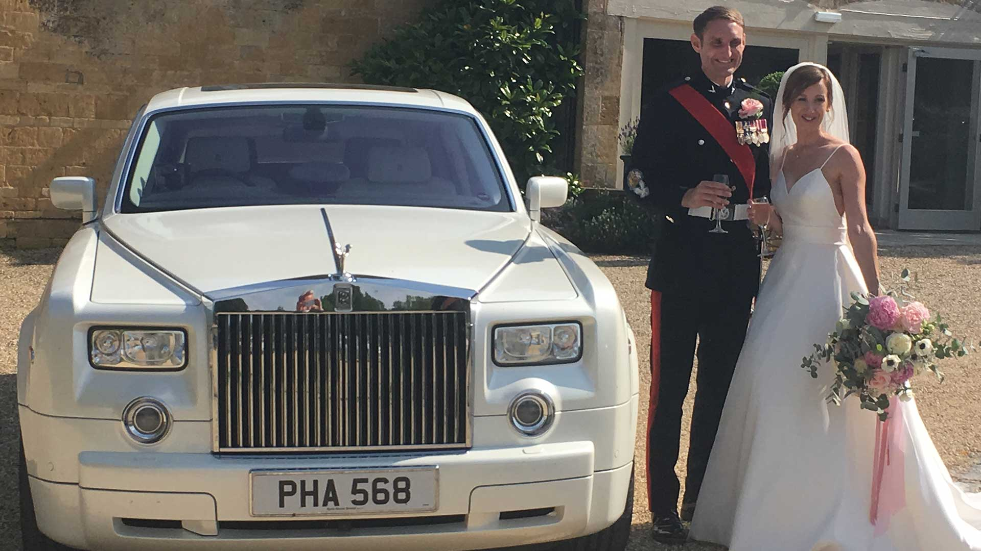 Anna and Andy with the Rolls-Royce Phantom white wedding car