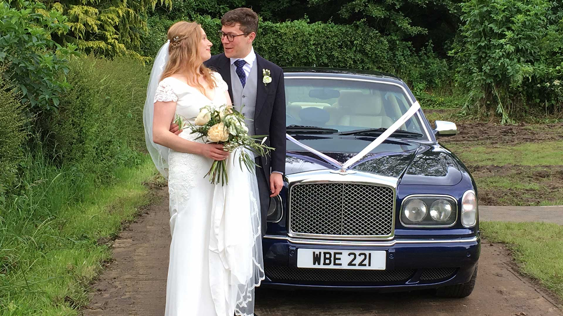 Ellie and Chris with the Bentley Arnage wedding car in Blue