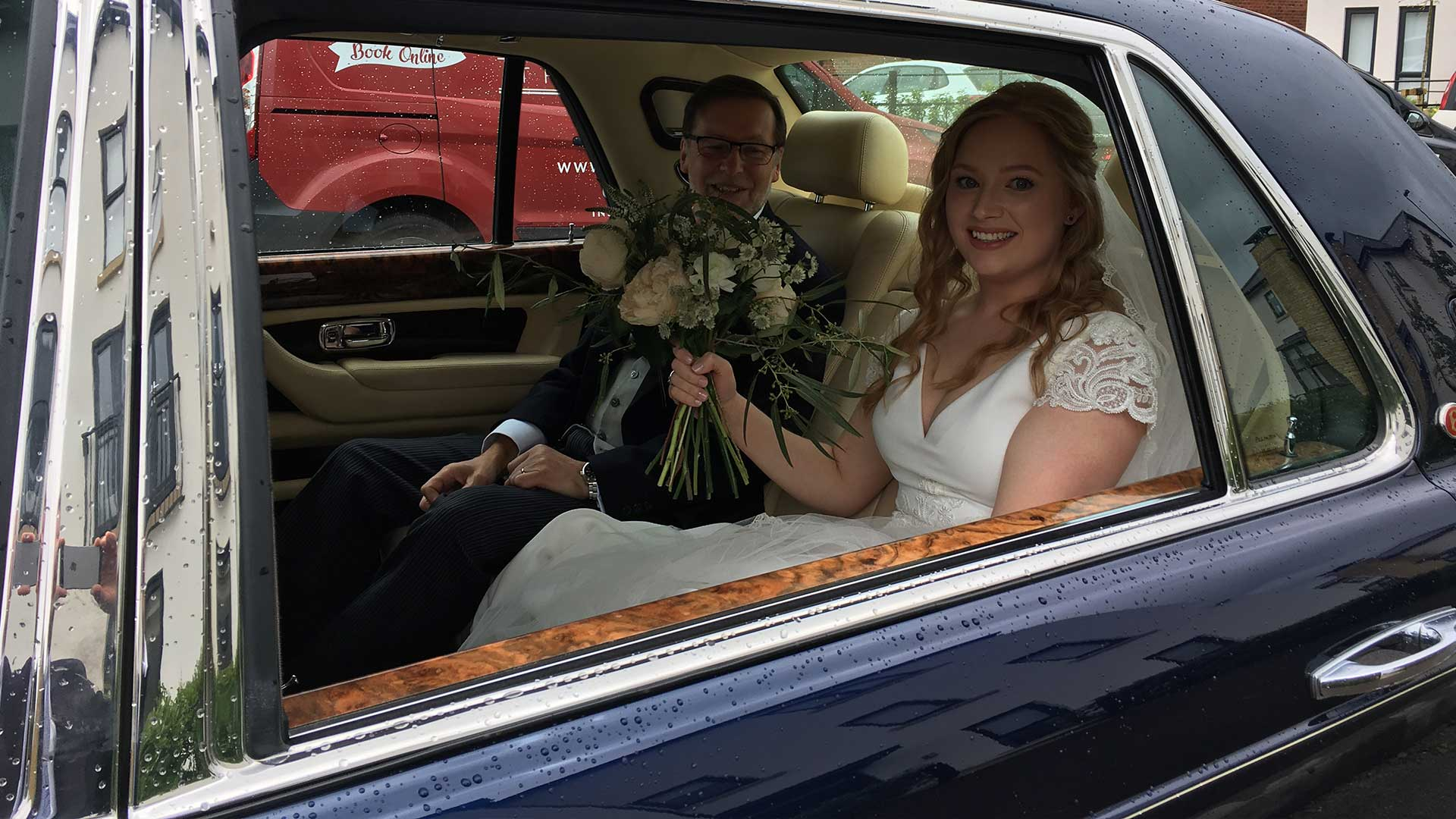 Ellie and father with the Bentley Arnage in Blue