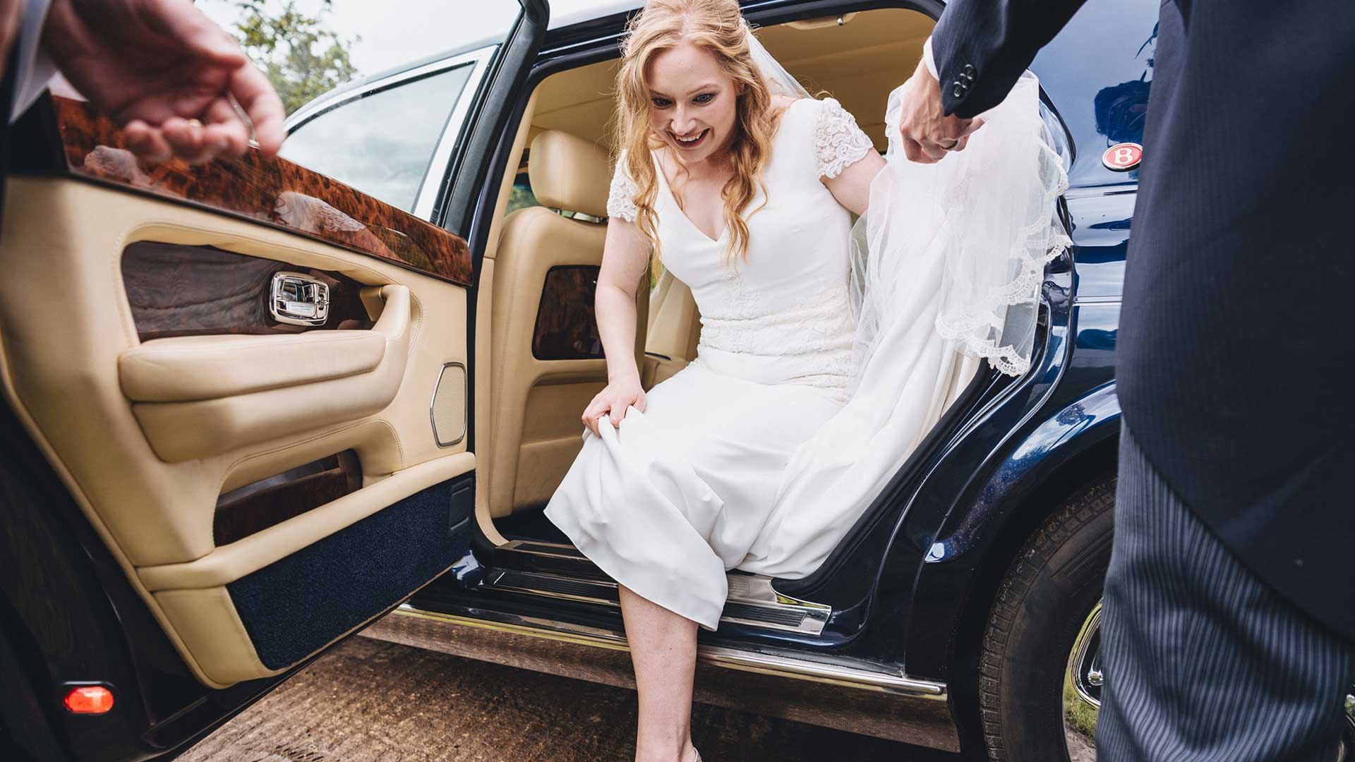 Ellie getting out of the Bentley Arnage in Blue