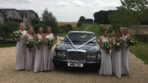 Fawn's bridesmaids with the Bentley Arnage wedding car