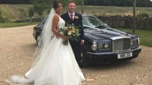 Fawn and Olly with the Bentley Arnage wedding car in Blue
