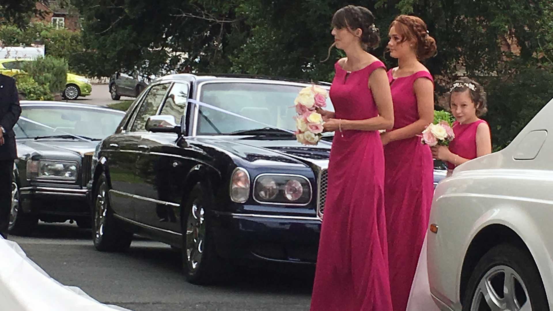 Bridesmaids with the Bentley Arnage wedding car in Blue