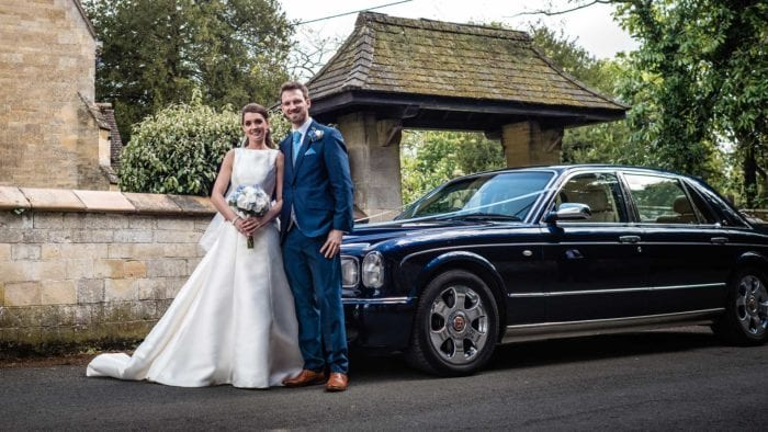 Newly-wed couple Amy and Jay with the Bentley Arnage wedding car in Blue