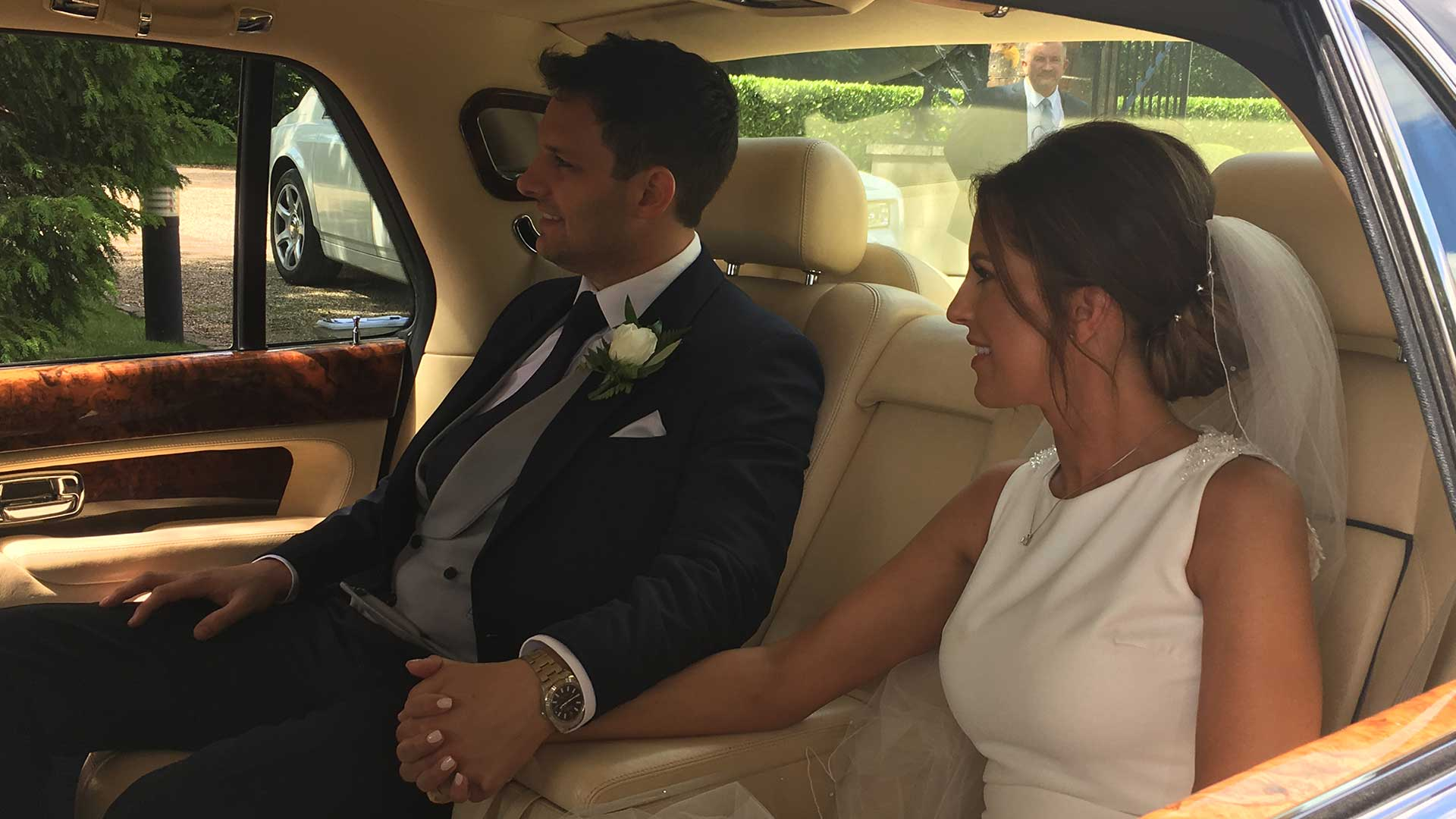 Laura and Rhys in the Bentley Arnage wedding car in Blue