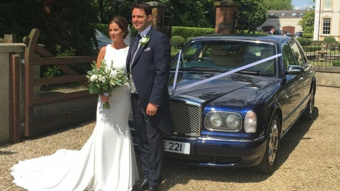 Laura and Rhys with the Bentley Arnage wedding car in Blue