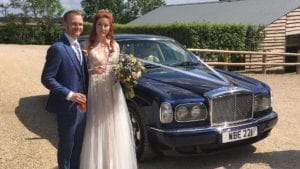 Olivia and Adam with the Bentley Arnage wedding car in Blue