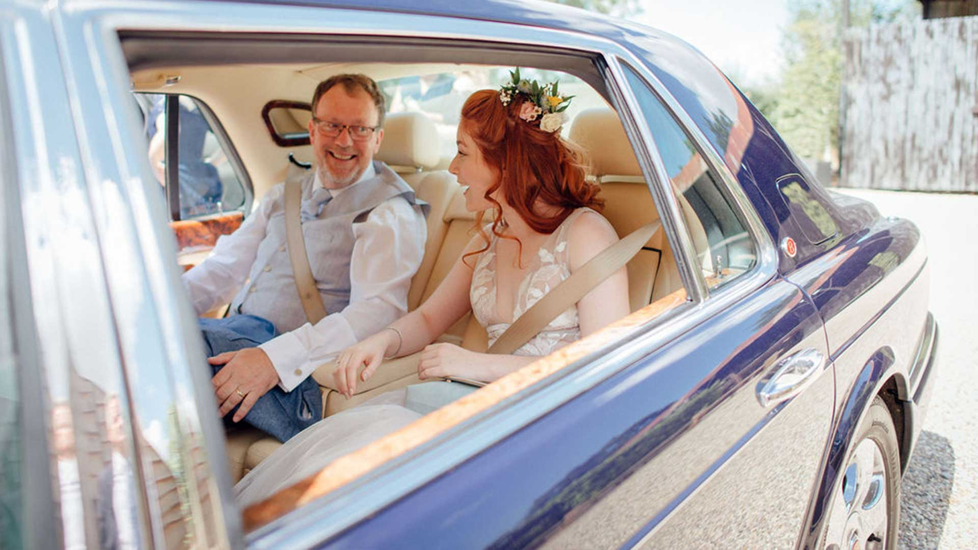 Olivia and father with the Bentley Arnage wedding car in Blue