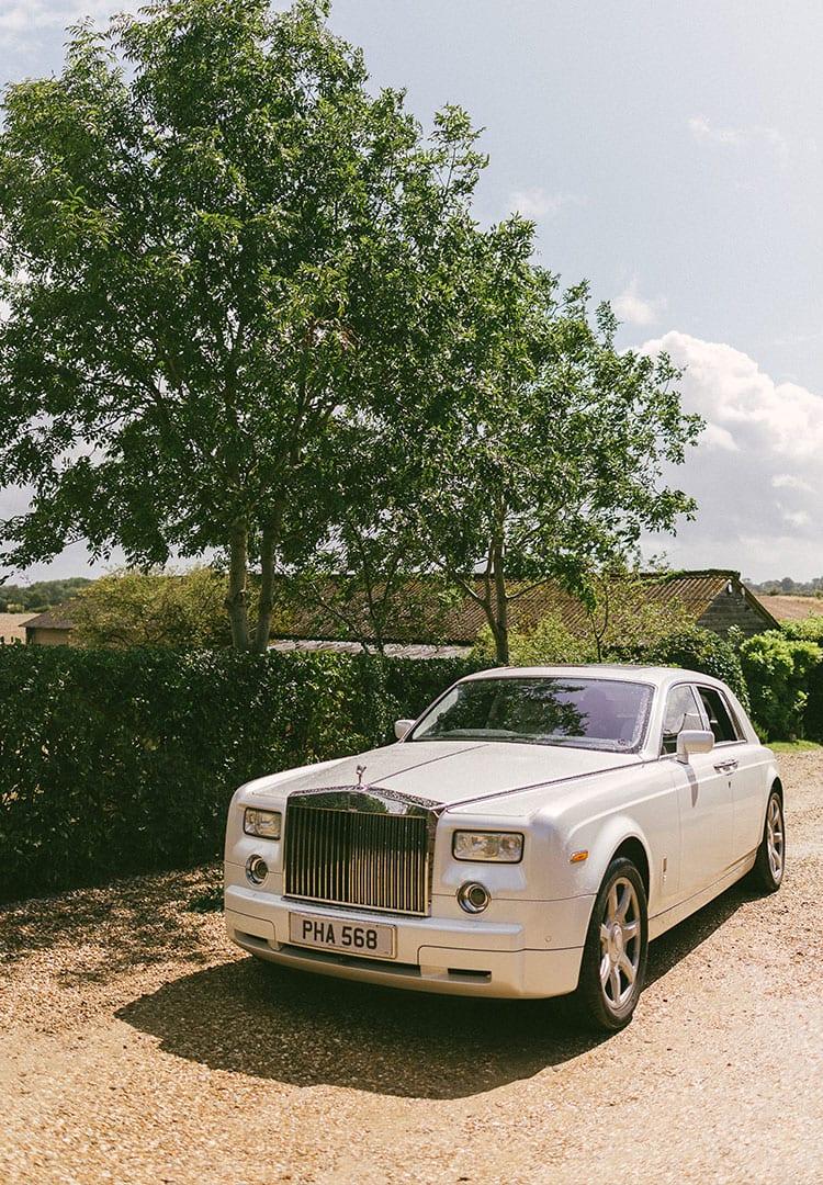 The Rolls-Royce wedding car in white
