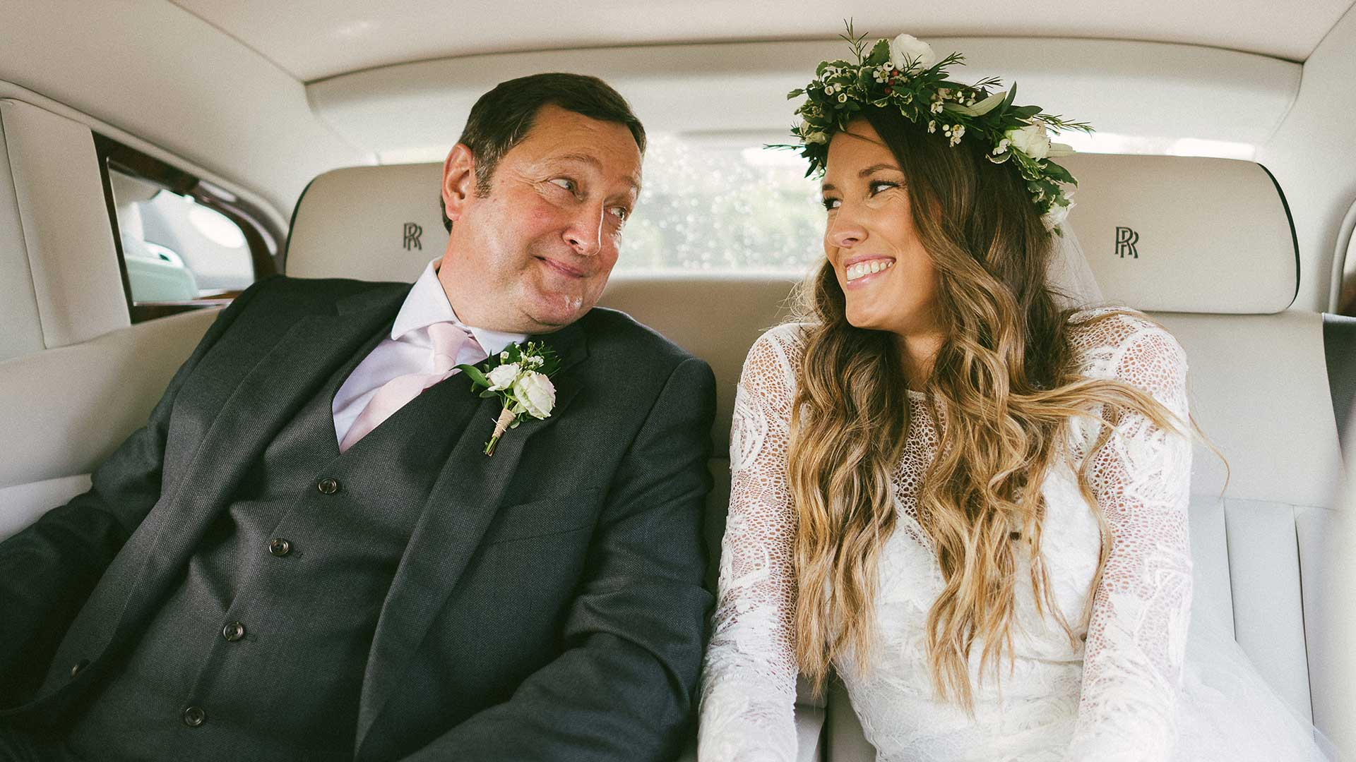 Becky and her father in the Rolls-Royce wedding car
