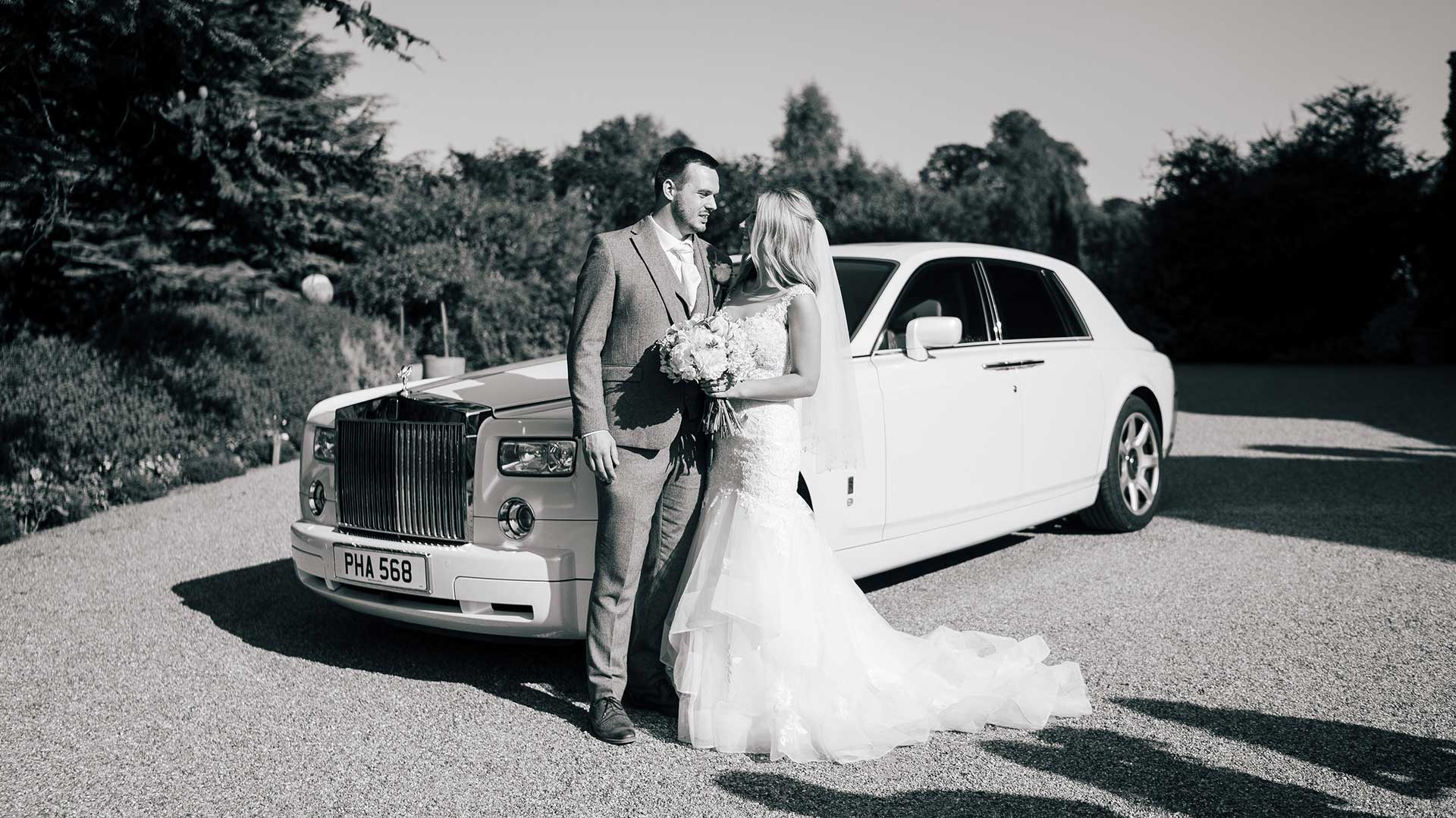 Callan and Carla with the Rolls-Royce wedding car in white