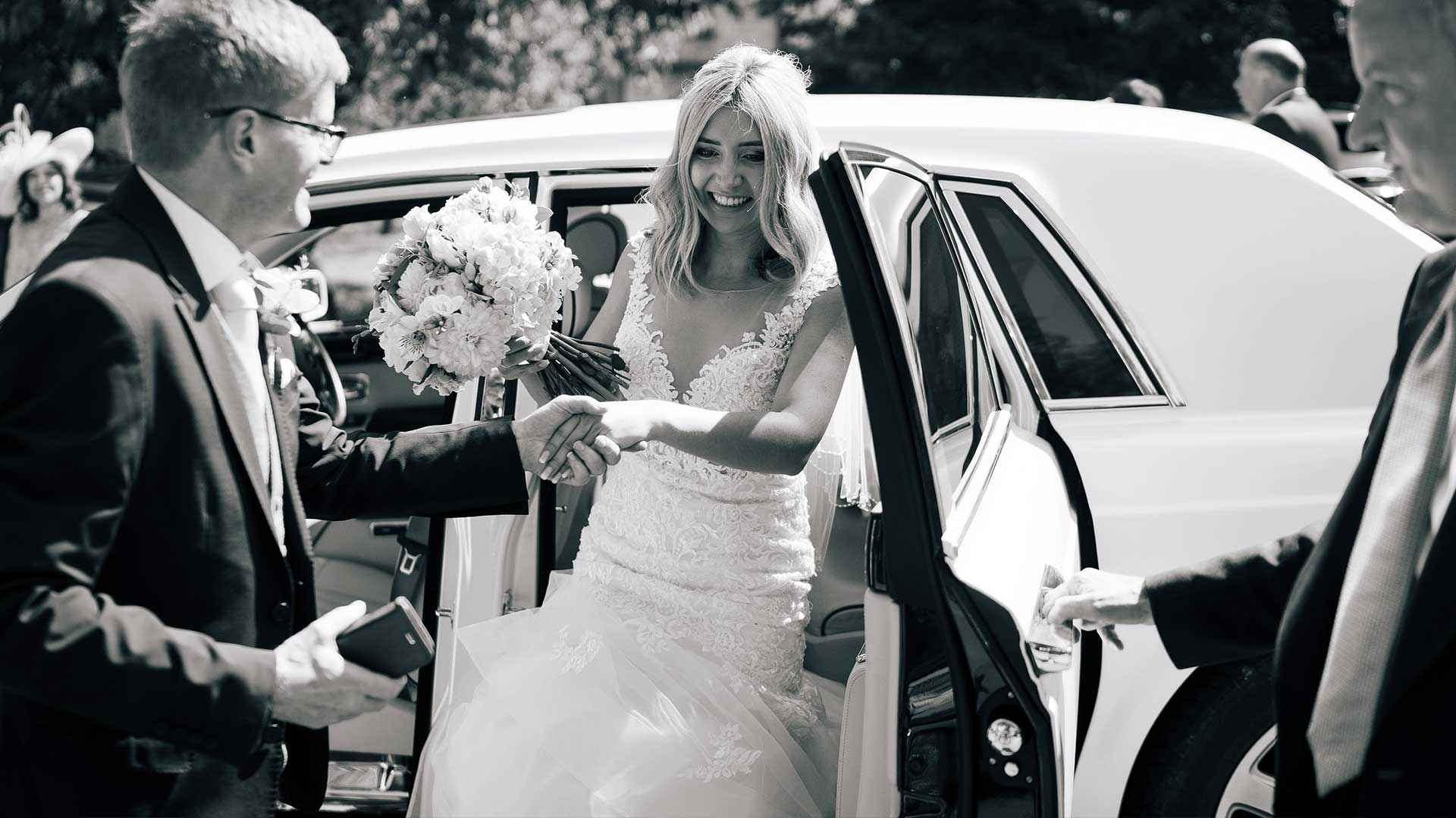 Carla getting out of the Rolls-Royce wedding car