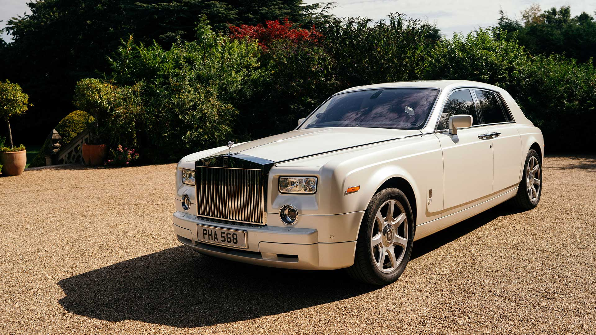 The Rolls-Royce wedding car in white
