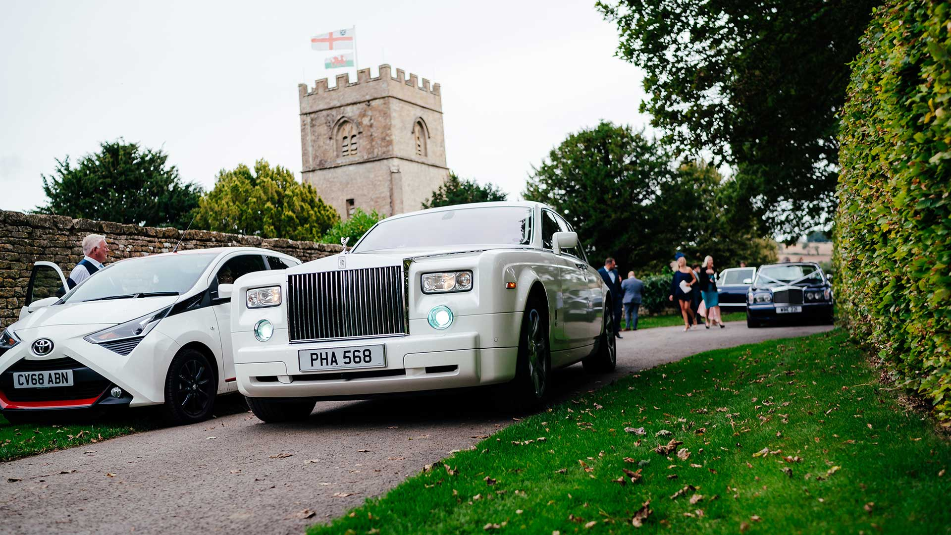 Rolls-Royce Phantom arriving at the church with the Bentley Arnage following