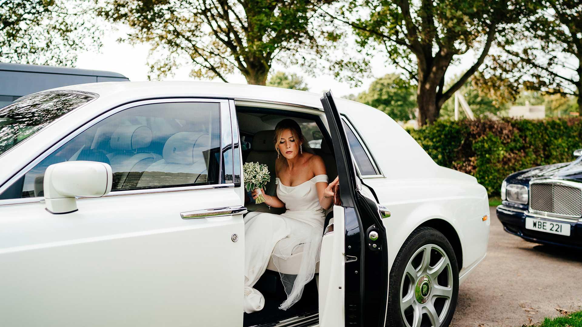 Katie in the Rolls-Royce Phantom wedding car