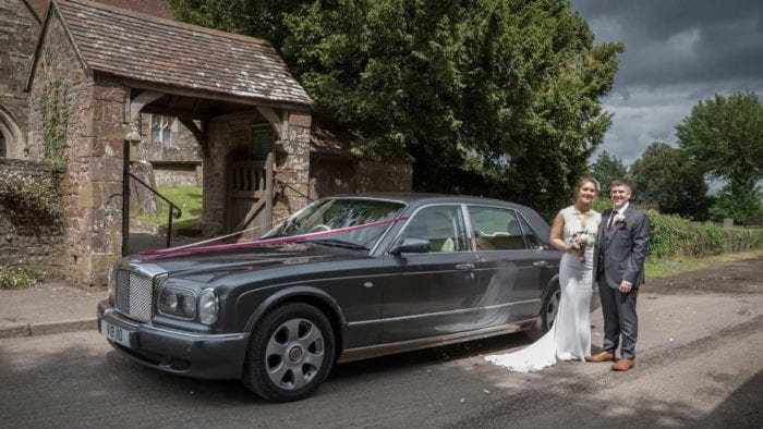 Lauren and Ashley with the Bentley Arnage wedding car in Grey