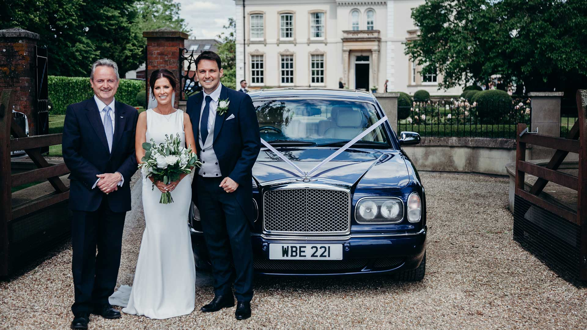 Rhys and Laura with David, owner of Azure Wedding Cars, with the Bentley Arnage in Blue
